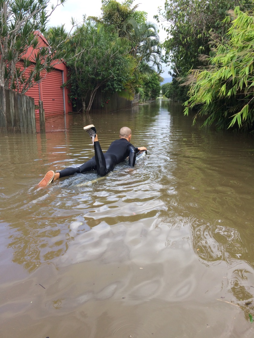 Surfing the floodwaters of a small flooded australian town