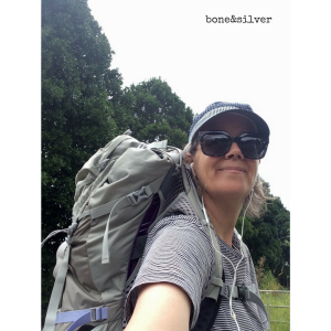 Walking up hills and mowing lawns in preparation for a hike, wearing a 50-litre backpack
