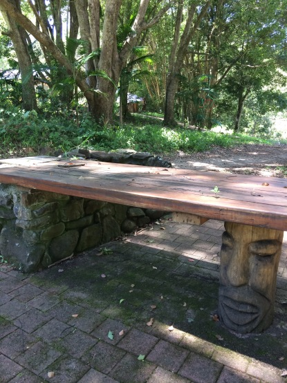 A hand-carved garden table on a retreat centre for Wellbeing
