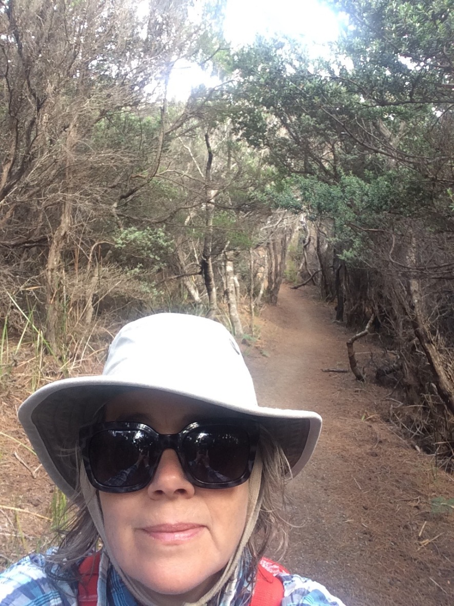 Selfie in a Tasmanian coastal forest for mindful wellbeing over 50