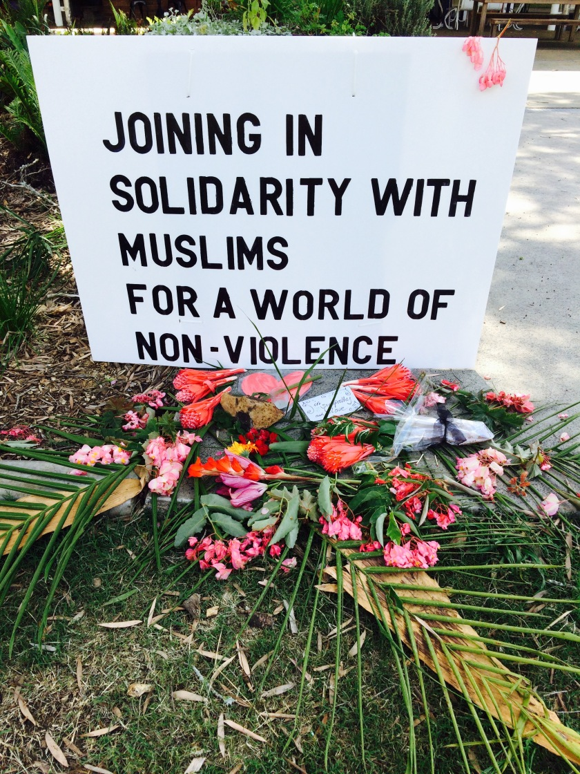Leaving flowers on an altar for peace after the New Zealand shootings